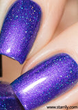 Indigo child is a unique indigo blue purple shimmery nail polish with holographic flakes