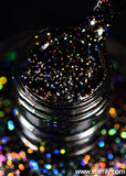 Neutrino is a jet black nail polish with bright silver holographic glitter