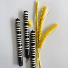 Load image into Gallery viewer, Jet Black and Pearl White Striped Candlesticks Set of Four - ad&i