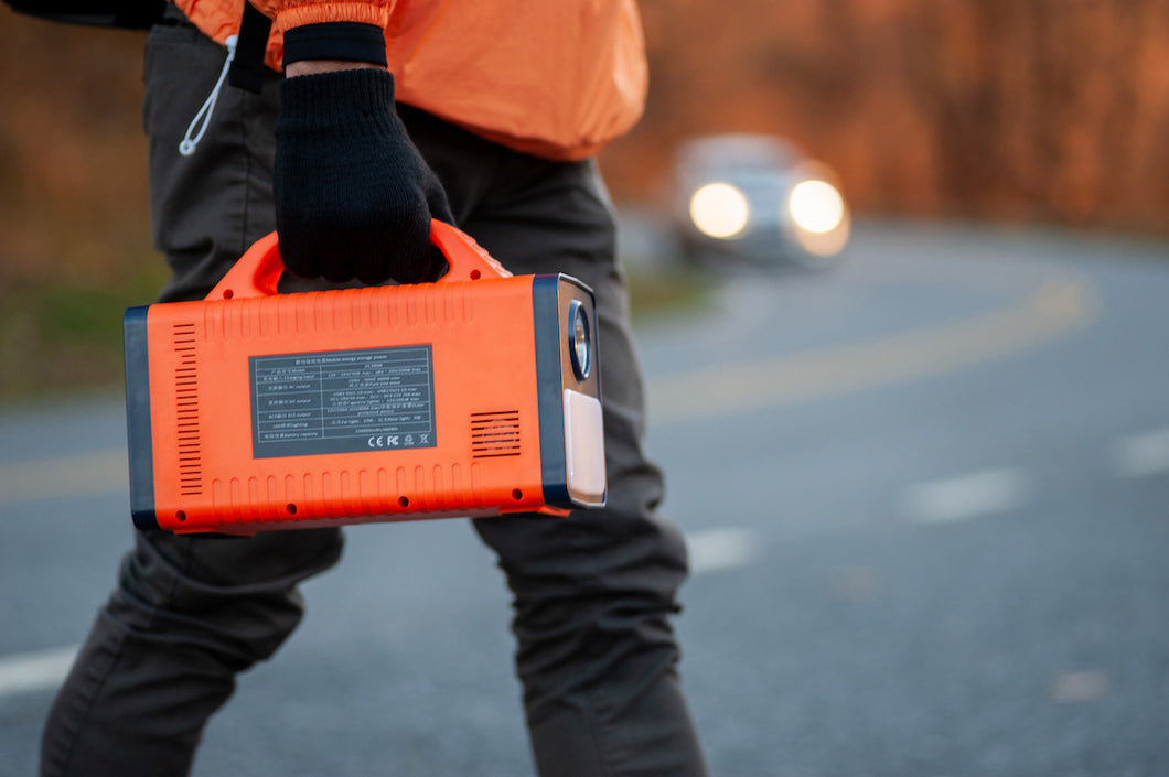 image of roadside worker carrying HIMCEN 450 portable power station