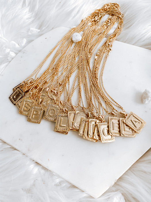 mila initial necklace on gold cube chain