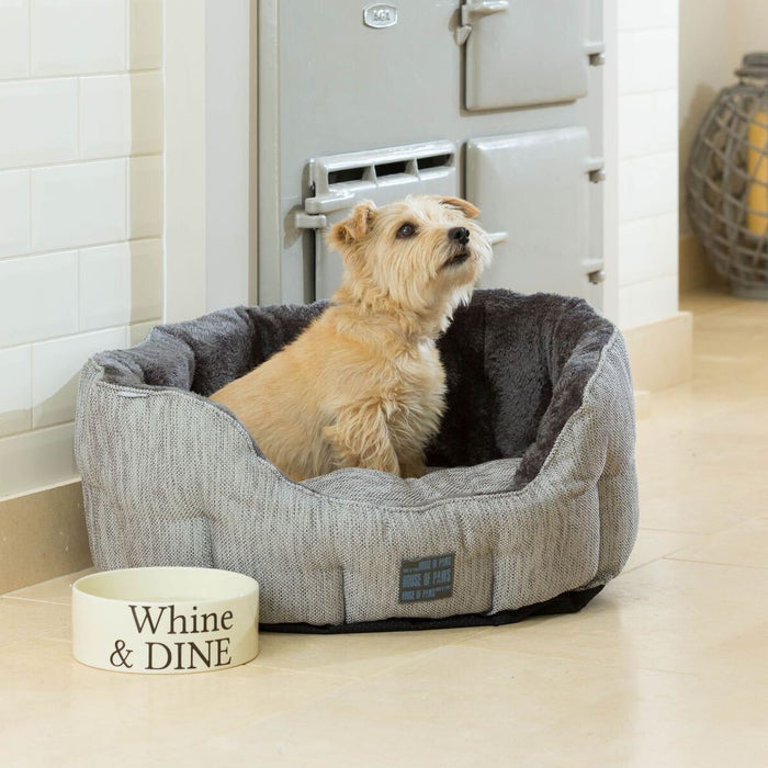 Kitchen image of a dog sitting in the House of Paws Grey Hessian & Plus Oval Bed