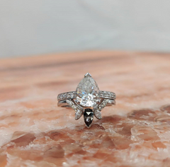 The 'tear drop' shape of this custom engagement ring is unique and beautiful.