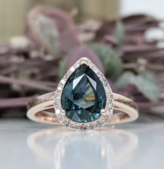 A jaw-dropping plain band pear halo ring