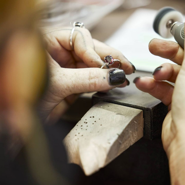 Custom engagement ring being polished.