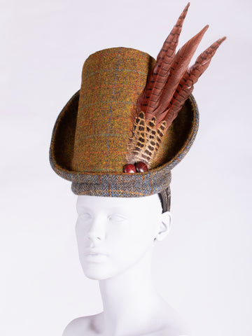Rust and sage Harris Tweed hat with pheasant feathers and leather buttons