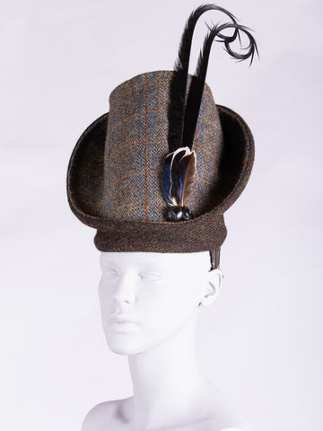 sage and chocolate Harris Tweed hat with long curled feathers and leather buttons