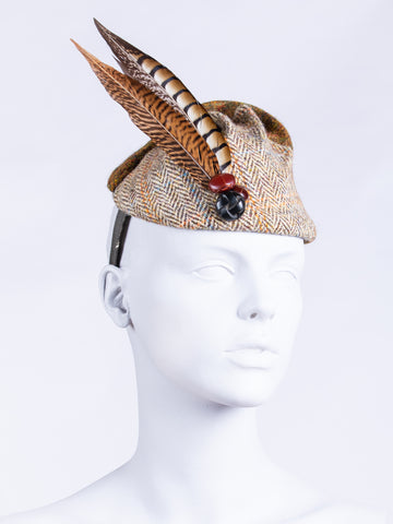 beige and moss green Harris Tweed hat with feathers