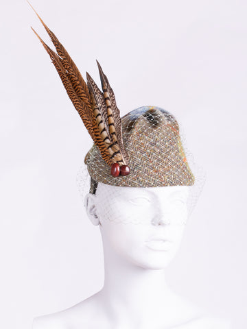 MacLeod and moss green tweed hat with long feather and veil