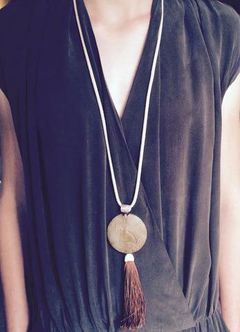 A semi precious stone, Silk tassel and Silver detail. A beautiful combination.