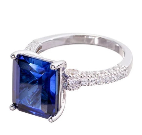 rings | faux blue sapphire emerald cut engagement ring images | Boutique CZ