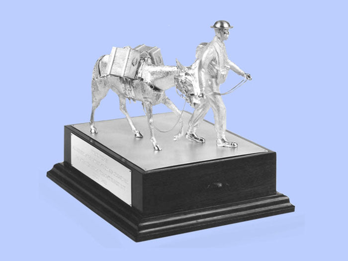 Silver Model of a Soldier with Mule