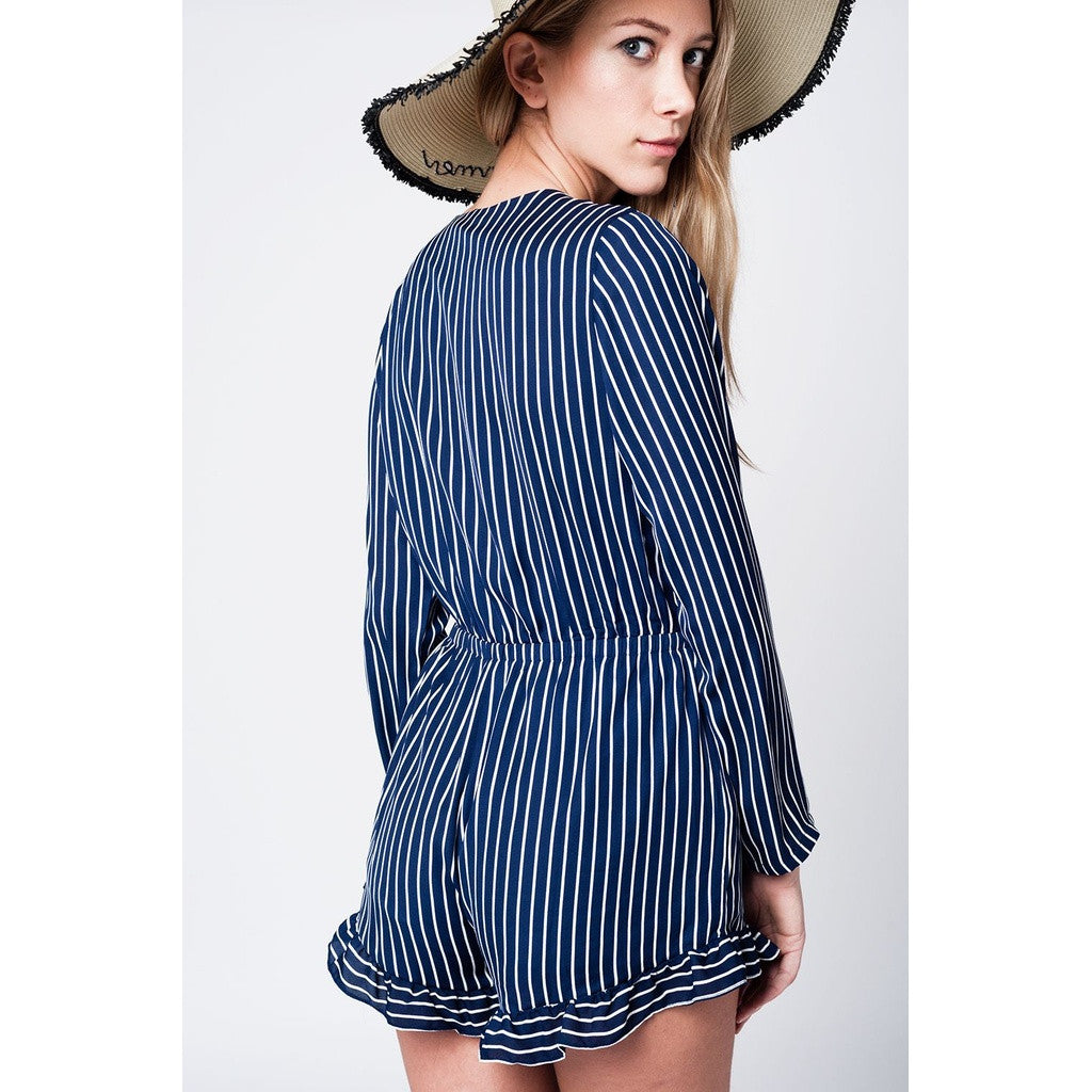 Navy striped romper with deep neckline and bow detail