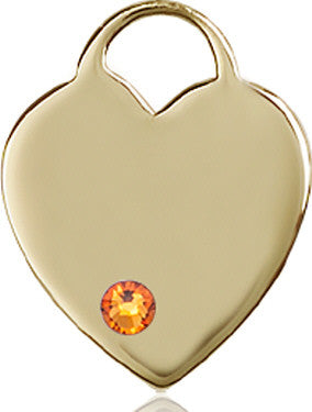 14kt Gold Heart Medal with 3mm Topaz bead.