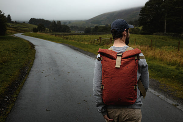Man walking in the Yorkshire Dales wearing a Bear backpack that has been made in England.