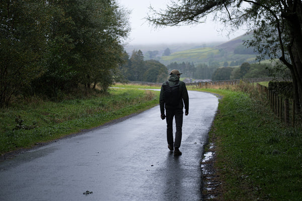 Man hiking in the hills wearing a Bear waxed canvas waterproof backpack in the yorkshire dales.