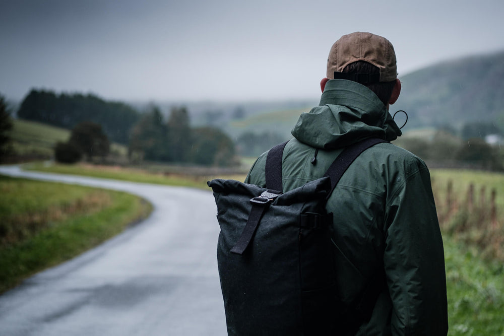 Man wearing a bear waxed canvas backpack in some of England finest countryside.