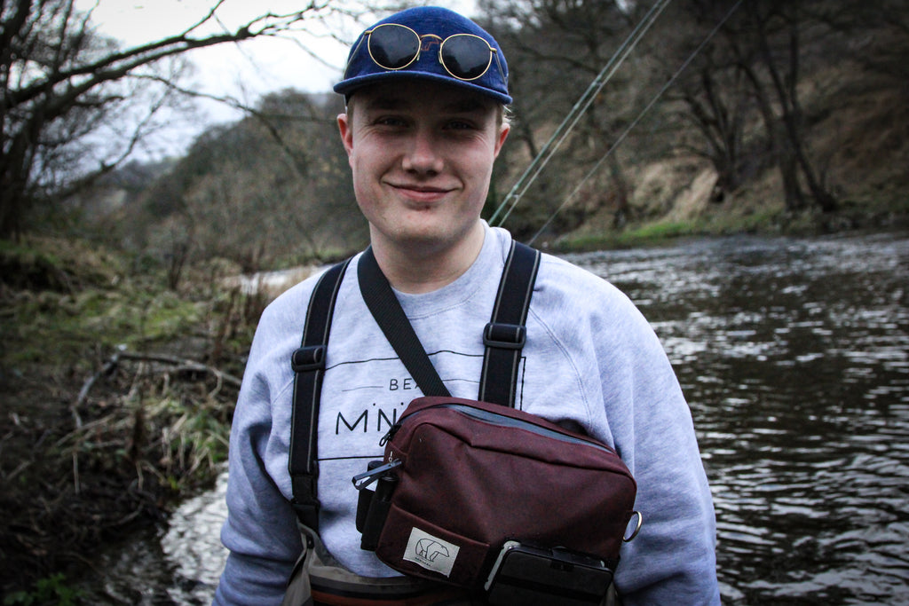 Oscar Boatfield, European Nymphing fly fishing expert and Co founder of Bear fly fishing, wearing a Bear Minimal universal fly fishing pack and Bear Minimal apparel.