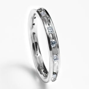 Channel setting diamond wedding band