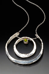 Peridot pendant with recycled sterling silver