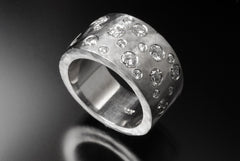 Recycled 14k white gold flat band with reused flush set diamonds