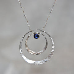 Polished sterling silver electron pendant