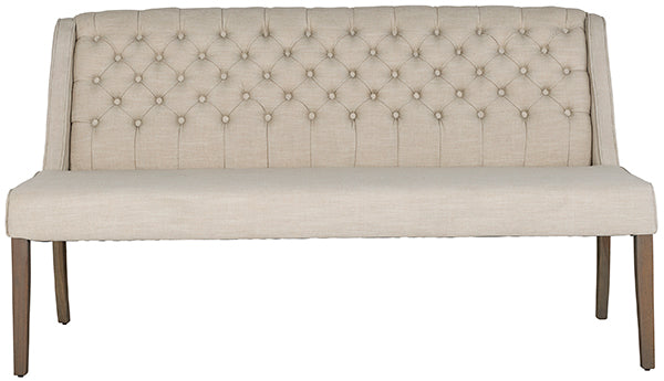 A cream button back dining bench on rustic wooden legs