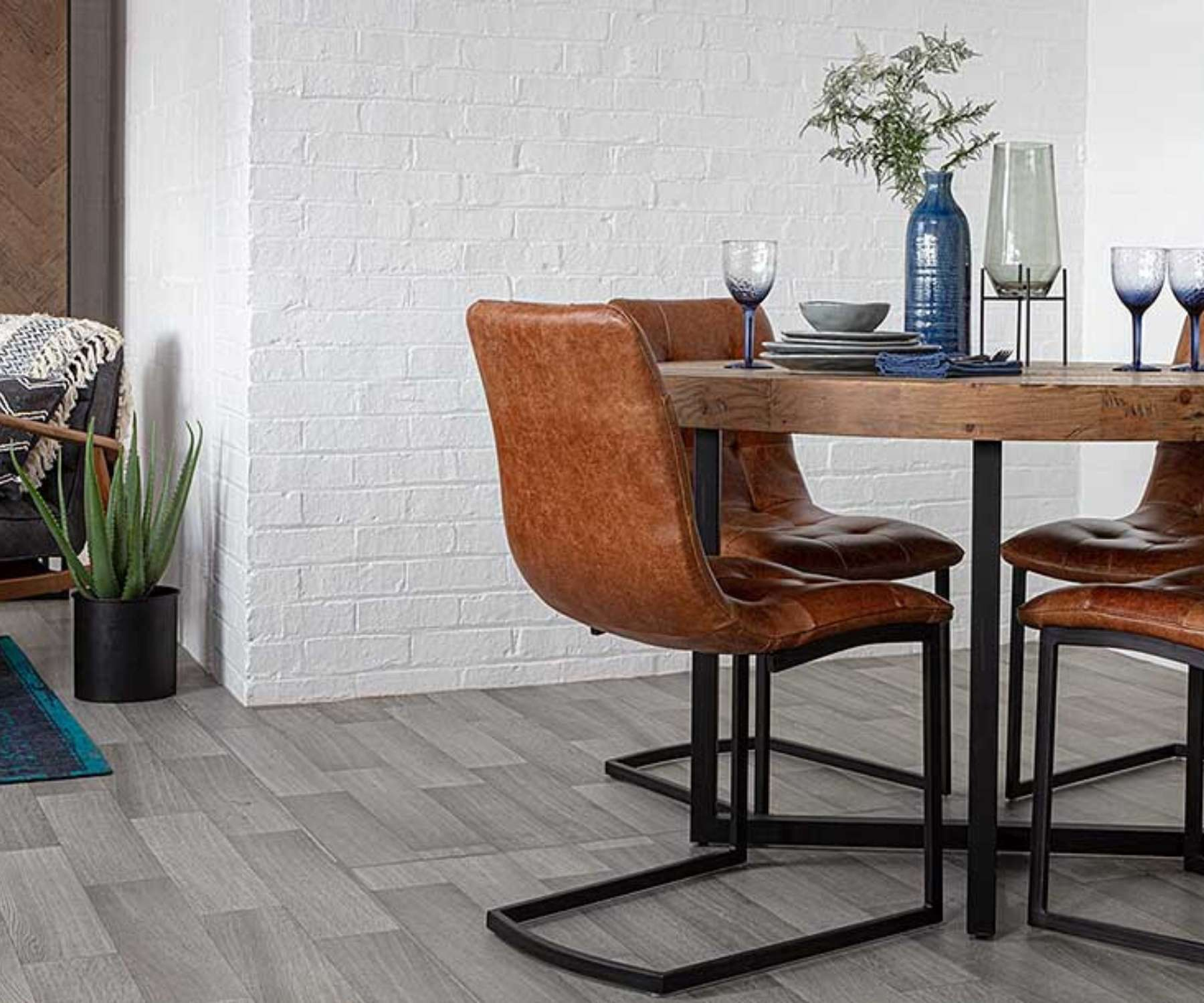 wood round table with faux brown leather chairs