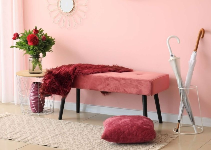 Pink fabric bench with umbrella and bright pink cushion