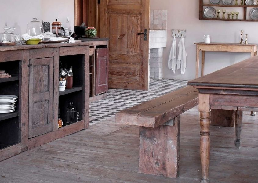 Farmhouse style dining room with large wooden sideboard and rustic dining bench