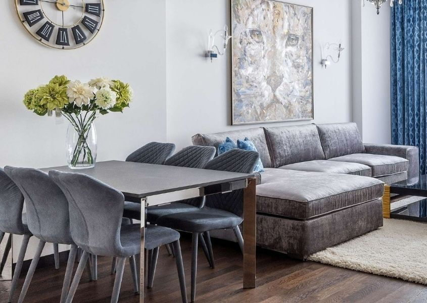 Grey fabric sofa with metal dining table and grey dining chairs