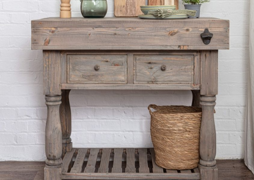 Rustic wooden butchers block with two drawers and basket on bottom shelf