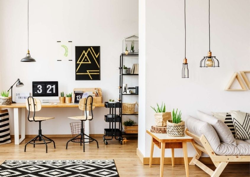 home office space with wooden desk in open plan living room