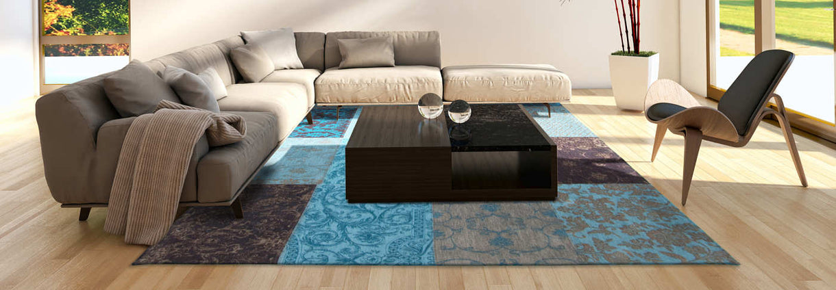 Louis De Poortere Turquoise Rug with White Leather Sofa