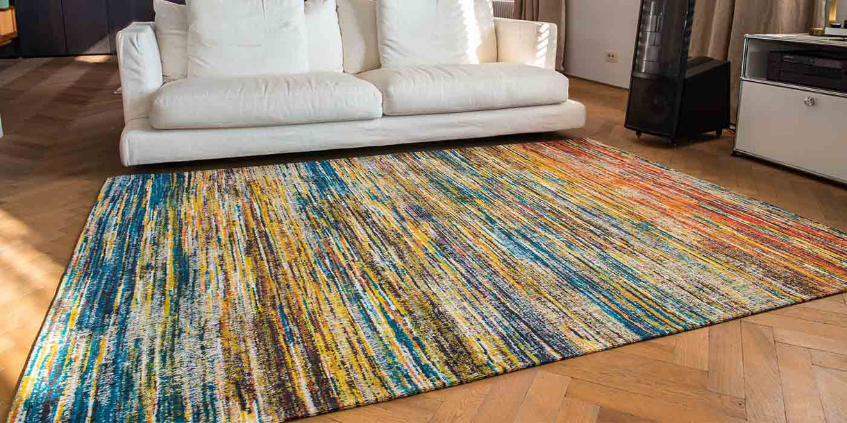 Louis de Poortere Sari Myriad Rug in Room with White Sofa