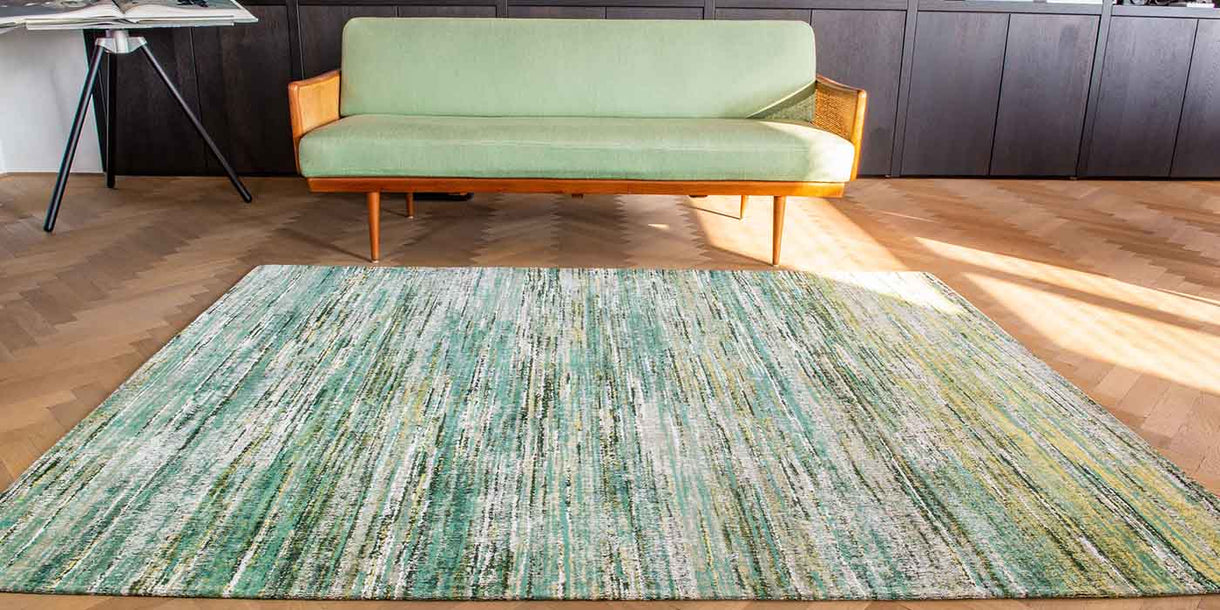 Louis de Poortere Sari Infinite Green Rug in Room with Green Sofa
