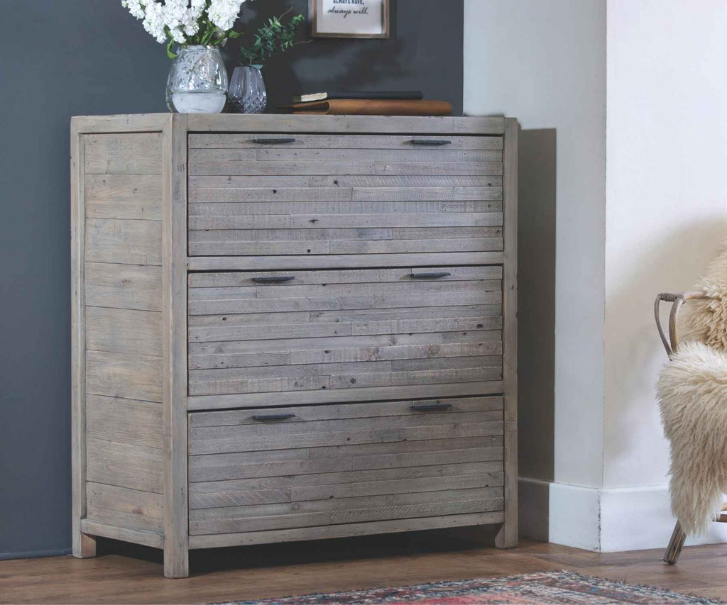 Reclaimed wood chest of drawers against blue wall