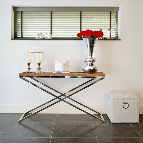 Red flowers on reclaimed wood and steel console table