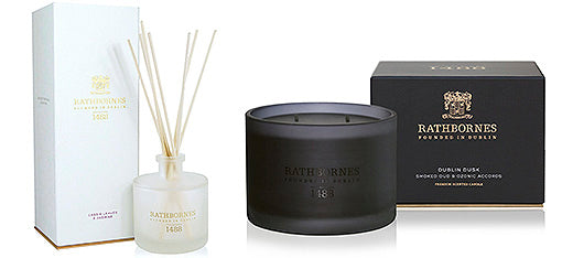 Scent diffuser in white glass pot and black scented candle