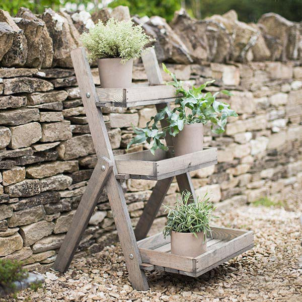 Small Wooden Aldsworth Pot Ladder with Plants in Garden