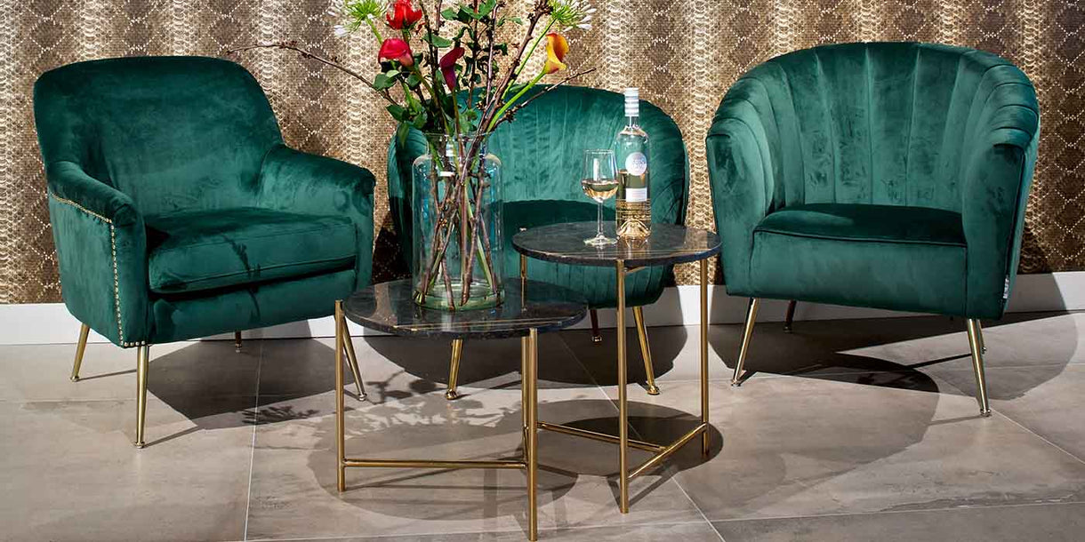 3 Green Velvet Armchairs with Gold Legs in Room with Coffee Tables