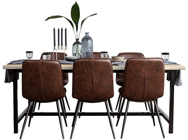 An industrial and rustic oak dining table with an H bar and tan dining chairs