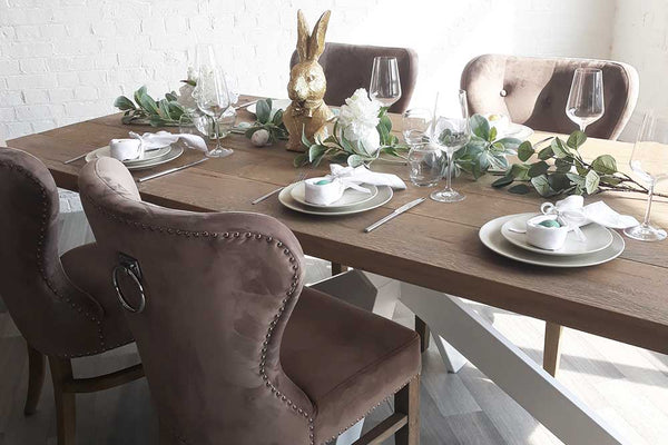 Oak Dining Table Set for Easter with Velvet Chairs and White Napkins