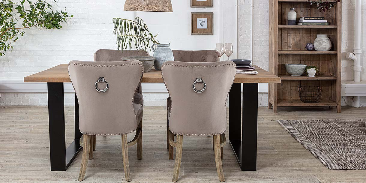 4 Luxe Daisy Taupe Velvet Dining Chairs around Oak Dining Table