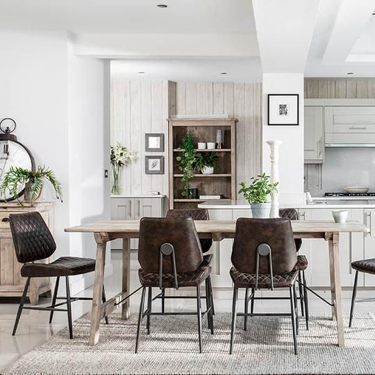 Industrial dining chairs with pale wooden dining table