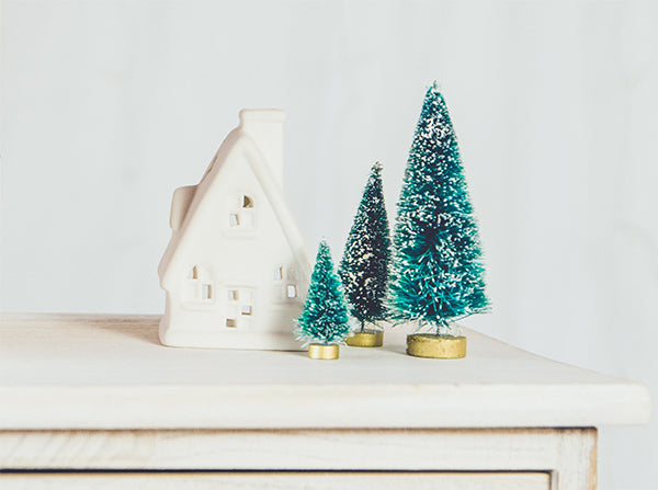 Artificial Christmas Trees on Sideboard