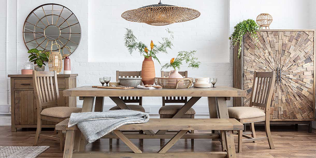Bamboo Manta Pendant Light above dining table with bench