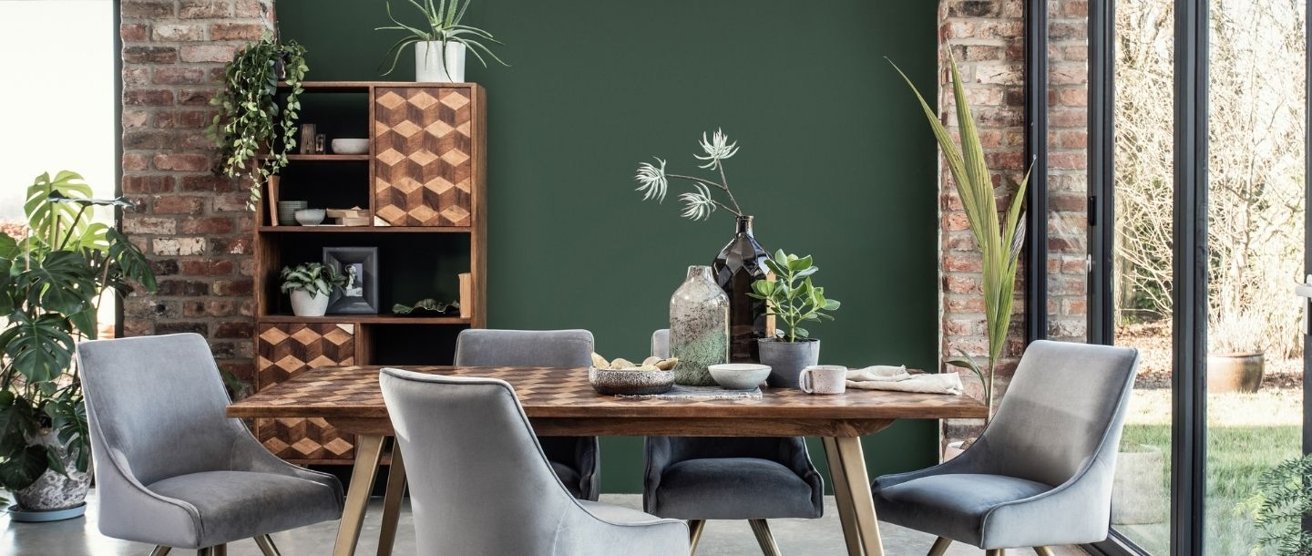 mango wooden bookshelf in dining space with dining room table and chairs