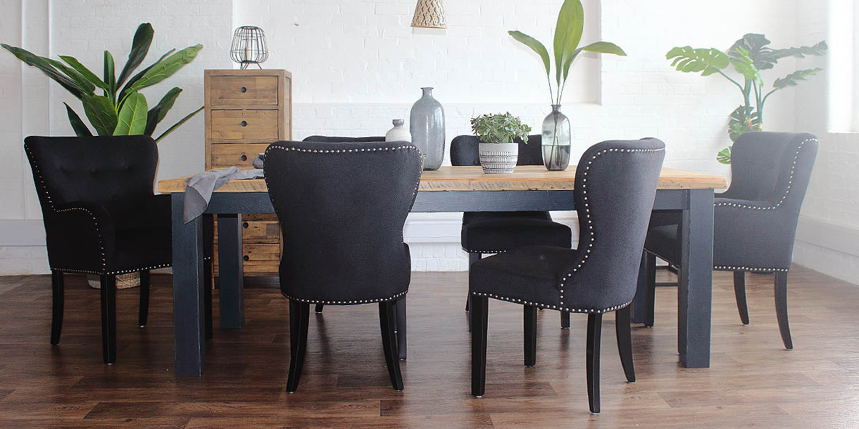 Beam Reclaimed Wood Dining Table and Black Fabric Dining Chairs