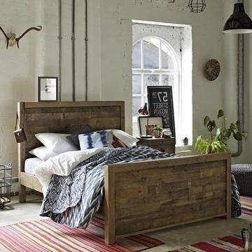 Reclaimed wood bed with high headboard